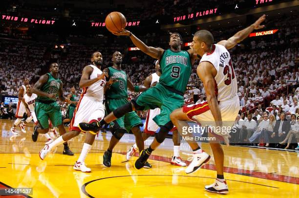 Rajon Rondo of the Boston Celtics attempts a shot in the first quarter as he drives and draws contact against Shane Battier of the Miami Heat in Game...