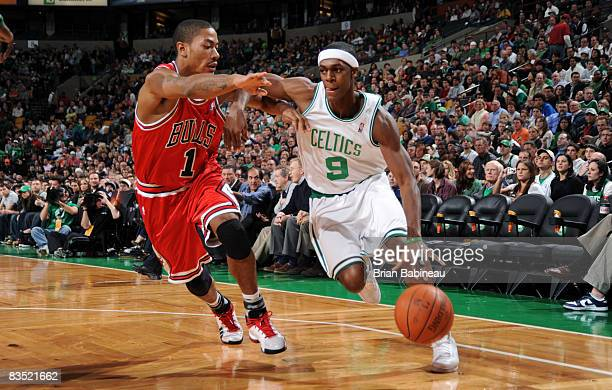 Rajon Rondo of the Boston Celtics dives the lane against Derrick Rose of the Chicago Bulls on October 31 2008 at the TD Banknorth Garden in Boston...