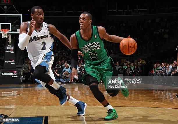 Rajon Rondo of the Boston Celtics drives against John Wall of the Washington Wizards at the Verizon Center on January 22 2011 in Washington DC NOTE...