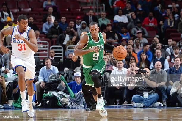 Rajon Rondo of the Boston Celtics drives down the court as Hollis Thompson of the Philadelphia 76ers chases afterduring the game on November 19 2014...