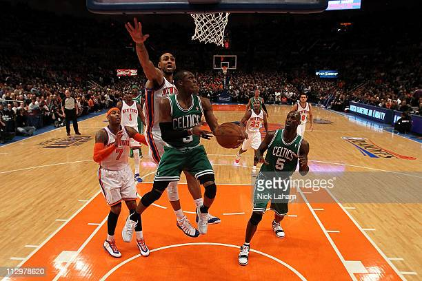 Rajon Rondo of the Boston Celtics drives for a shot attempt against Jared Jeffries of the New York Knicks in Game Three of the Eastern Conference...
