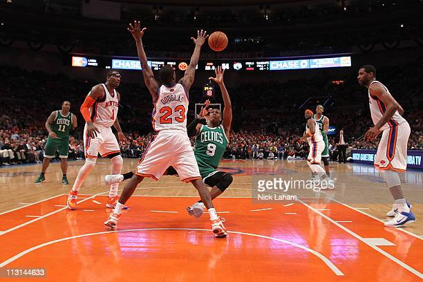 Rajon Rondo of the Boston Celtics drives for a shot attempt against Toney Douglas of the New York Knicks in Game Four of the Eastern Conference...