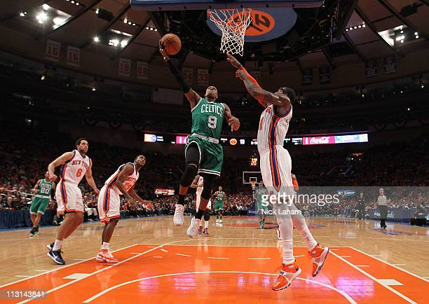 Rajon Rondo of the Boston Celtics drives for a shot attempt in the first half against Amar'e Stoudemire of the New York Knicks in Game Four of the...
