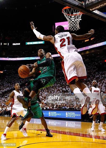Rajon Rondo of the Boston Celtics drives for a shot attempt in the first quarter against Ronny Turiaf of the Miami Heat in Game One of the Eastern...