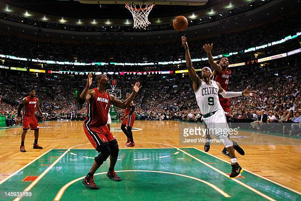 Rajon Rondo of the Boston Celtics drives for a shot attempt in the first half against Chris Bosh and Udonis Haslem of the Miami Heat in Game Six of...