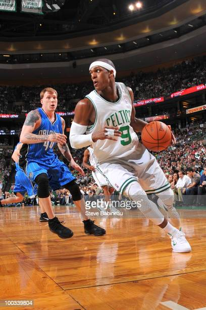 Rajon Rondo of the Boston Celtics drives the lane against Jason Williams of the Orlando Magic in Game Three of the Eastern Conference Finals during...