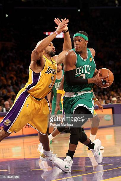 Rajon Rondo of the Boston Celtics drives to the basket against Derek Fisher of the Los Angeles Lakers in Game One of the 2010 NBA Finals at Staples...