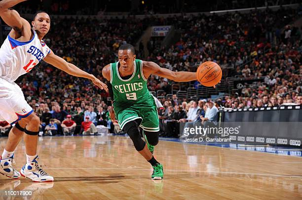 Rajon Rondo of the Boston Celtics drives to the basket against Evan Turner of the Philadelphia 76ers on March 11 2011 at the Wells Fargo Center in...