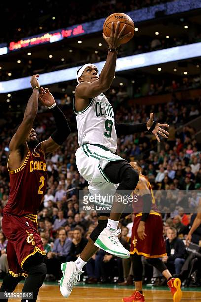 Rajon Rondo of the Boston Celtics drives to the basket against Kyrie Irving of the Cleveland Cavaliers in the first half at TD Garden on November 14...