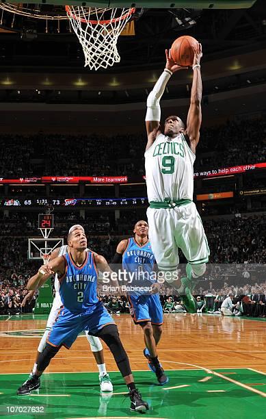 Rajon Rondo of the Boston Celtics dunks the ball against the Oklahoma City Thunder on November 19 2010 at the TD Garden in Boston Massachusetts NOTE...