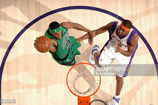Rajon Rondo of the Boston Celtics elevates for a dunk against D.J. Strawberry of the Phoenix Suns during the game at U.S. Airways Center on February...