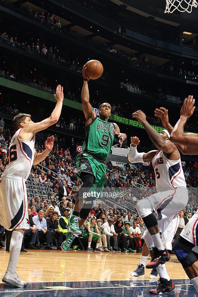 Rajon Rondo #9 of the Boston Celtics glides to the basket against the Atlanta Hawks at the Philips Arena on January 25, 2013 in Atlanta, Georgia.