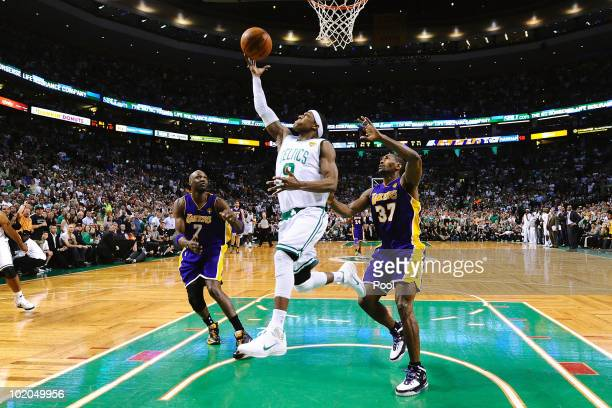 Rajon Rondo of the Boston Celtics goes to the basket against Lamar Odom and Ron Artest of the Los Angeles Lakers during Game Five of the 2010 NBA...