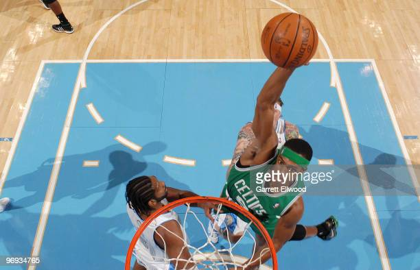 Rajon Rondo of the Boston Celtics goes to the basket against Nene of the Denver Nuggets on February 21 2010 at the Pepsi Center in Denver Colorado...