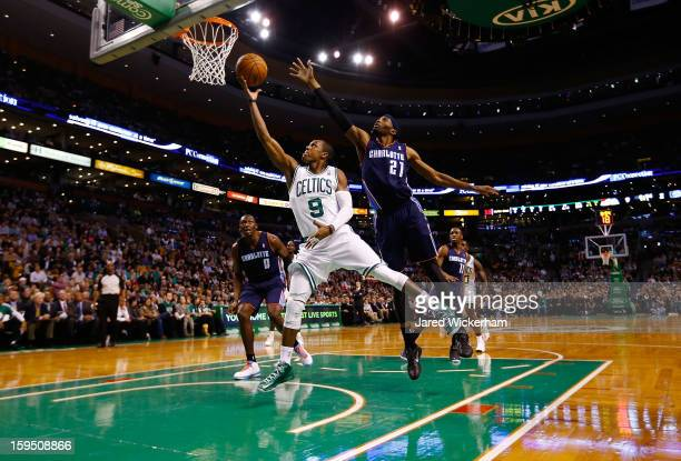 Rajon Rondo of the Boston Celtics goes up for a layup in front of Hakim Warrick of the Charlotte Bobcats during the game on January 14 2013 at TD...