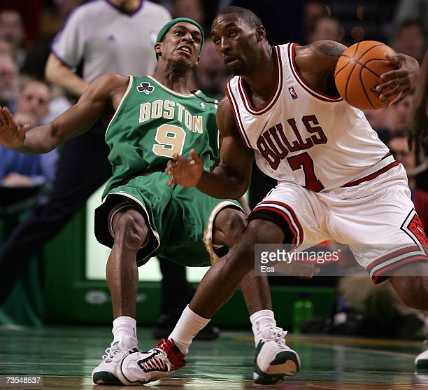 Rajon Rondo of the Boston Celtics is knocked down by Ben Gordon of the Chicago Bulls on March 11 2007 at the TD Banknorth Garden in Boston...