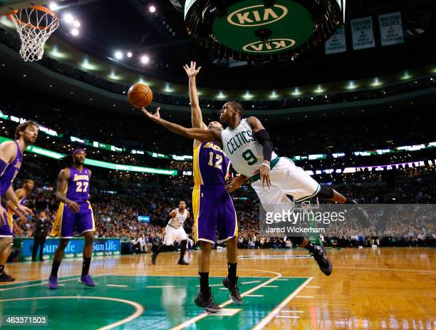 Rajon Rondo of the Boston Celtics is midair for a layup in front of Kendall Marshall of the Los Angeles Lakers in the second quarter during the game...