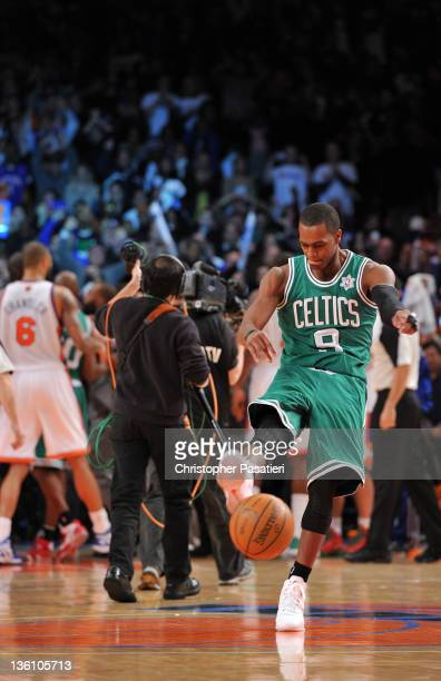 Rajon Rondo of the Boston Celtics kicks the basketball after losing to the New York Knicks at Madison Square Garden on December 25 2011 in New York...