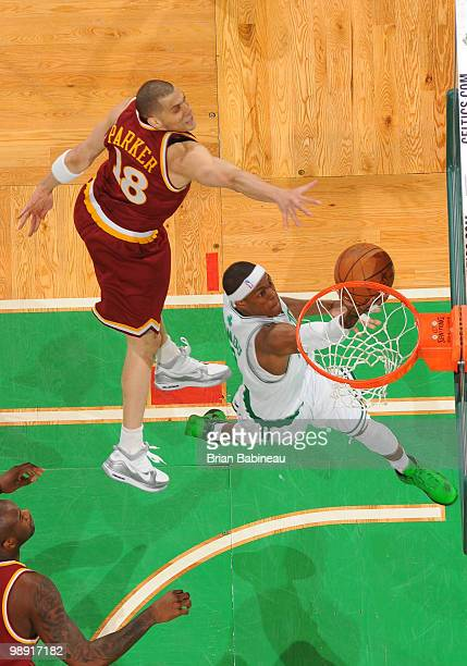 Rajon Rondo of the Boston Celtics lays the ball in the basket against Anthony Parker of the Cleveland Cavaliers in Game Three of the Eastern...