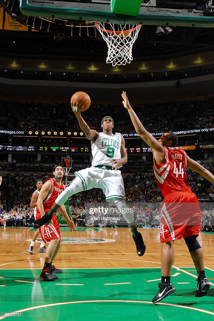 Rajon Rondo #9 of the Boston Celtics lays the ball up in the lane against Chuck Hayes #44 of the Houston Rockets on April 2, 2010 at the TD Garden in Boston, Massachusetts.
