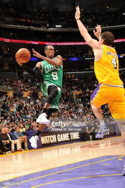 Rajon Rondo of the Boston Celtics looks to pass against Luke Walton of the Los Angeles Lakers at Staples Center on January 30 2011 in Los Angeles...