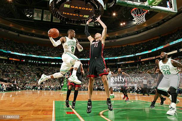Rajon Rondo of the Boston Celtics looks to pass against Zydrunas Ilgauskas of the Miami Heat during Game Four of the Eastern Conference Semifinals in...