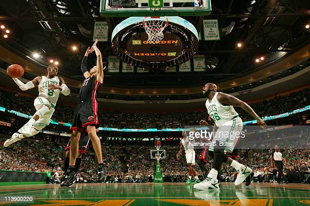 Rajon Rondo of the Boston Celtics looks to pass to Shaquille O'Neal against Zydrunas Ilgauskas of the Miami Heat during Game Four of the Eastern...