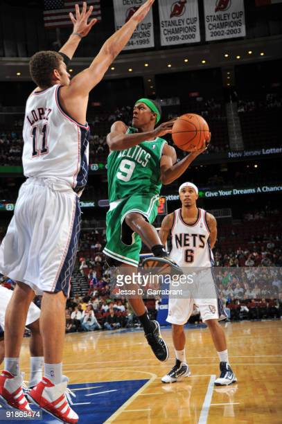 Rajon Rondo of the Boston Celtics passes against Brook Lopez of the New Jersey Nets during the preseason game on October 13 2009 at the Prudential...