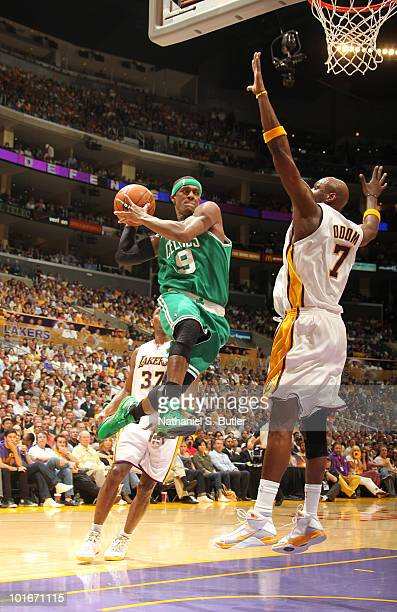 Rajon Rondo of the Boston Celtics passes against Lamar Odom of the Los Angeles Lakers in Game Two of the 2010 NBA Finals on June 6 2010 at Staples...