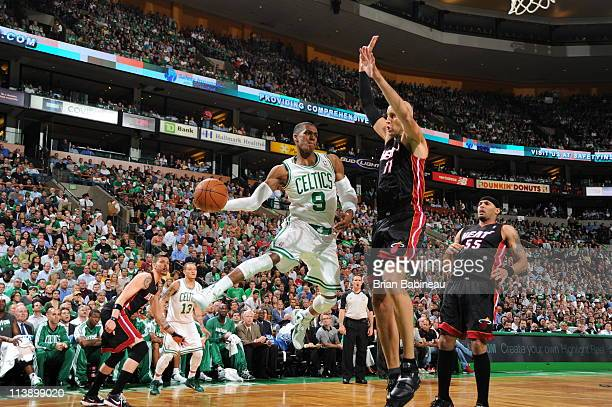 Rajon Rondo of the Boston Celtics passes against Zydrunas Ilgauskas of the Miami Heat in Game Four of the Eastern Conference Semifinals in the 2011...