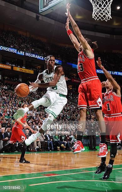 Rajon Rondo of the Boston Celtics passes the ball against Joakim Noah of the Chicago Bulls on December 3 2010 at the TD Garden in Boston...