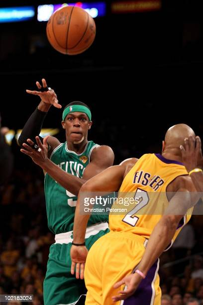 Rajon Rondo of the Boston Celtics passes the ball over Derek Fisher of the Los Angeles Lakers in Game Seven of the 2010 NBA Finals at Staples Center...