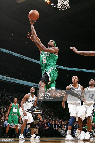Rajon Rondo of the Boston Celtics shoots against Gilbert Arenas of the Washington WIzards at the Verizon Center on December 10 2009 in Washington DC...
