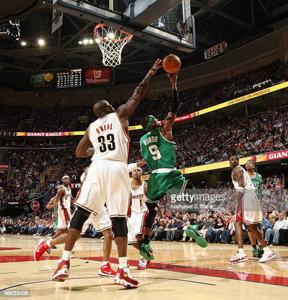 Rajon Rondo of the Boston Celtics shoots against Shaquille O'Neal of the Cleveland Cavaliers in Game Five of the Eastern Conference Semifinals during...