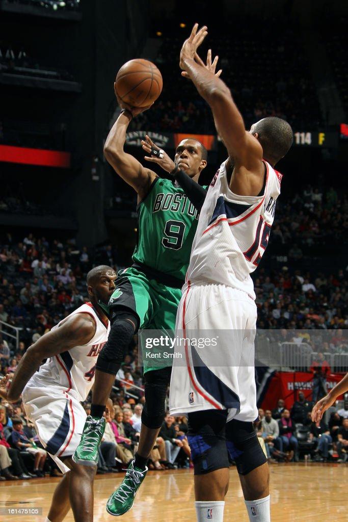 Rajon Rondo #9 of the Boston Celtics shoots over Al Horford #15 of the Atlanta Hawks at the Philips Arena on January 25, 2013 in Atlanta, Georgia.