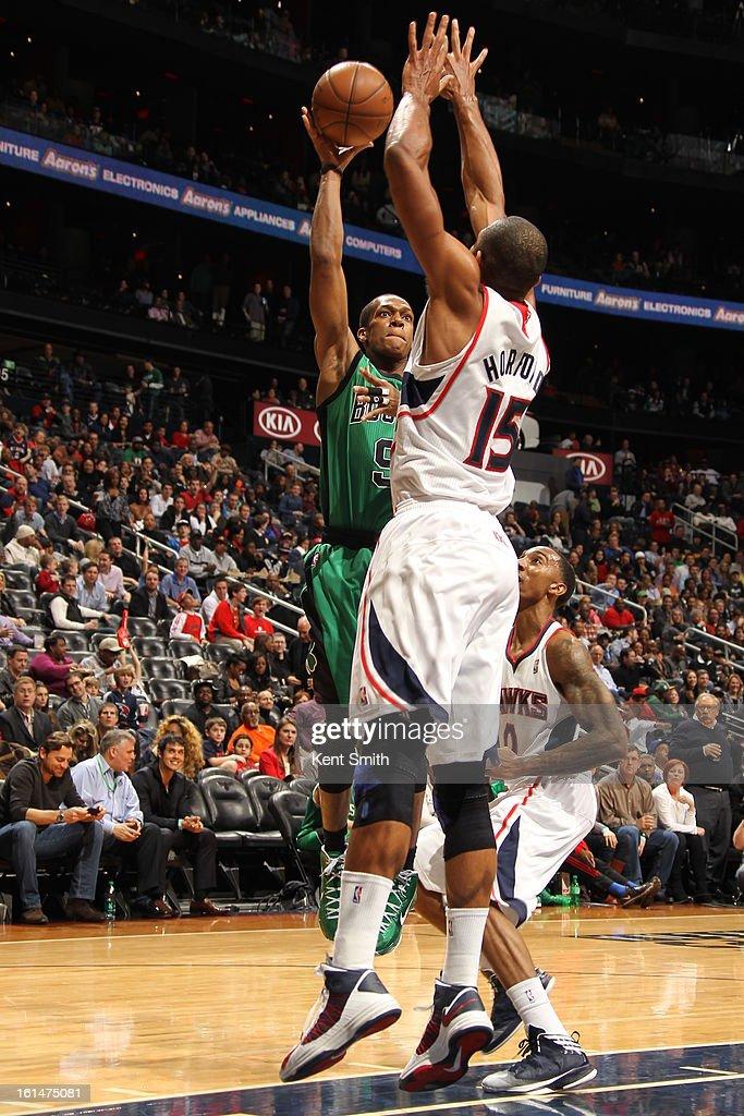 Rajon Rondo #9 of the Boston Celtics shoots over top of Al Horford #15 of the Atlanta Hawks at the Philips Arena on January 25, 2013 in Atlanta, Georgia.