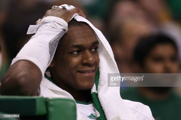 Rajon Rondo of the Boston Celtics smiles as he looks on from the bench late in the game against the Orlando Magic at TD Banknorth Garden in Game...