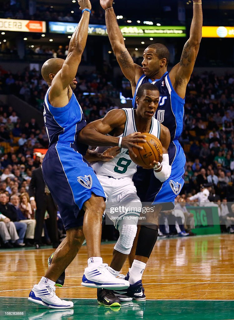 Rajon Rondo #9 of the Boston Celtics splits two defenders including Derek Fisher #6 of the Dallas Mavericks during the game on December 12, 2012 at TD Garden in Boston, Massachusetts.
