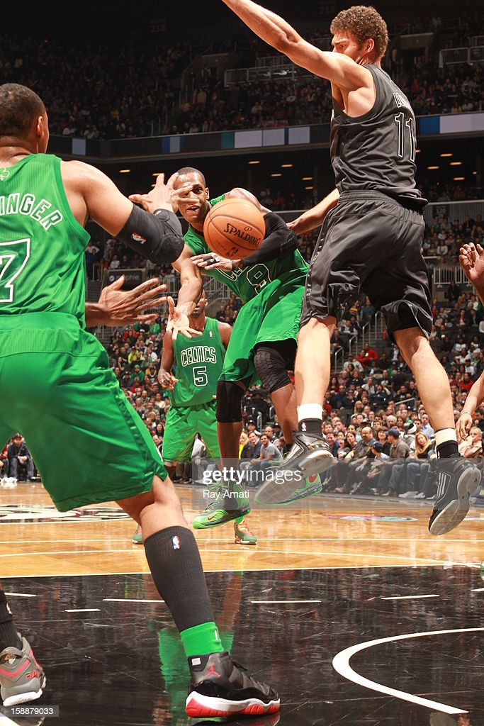 Rajon Rondo #9 of the Boston Celtics throws a pass against Brook Lopez #11 of the Brooklyn Nets on December 25, 2012 at the Barclays Center in Brooklyn, New York.