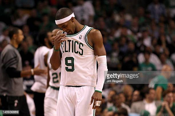 Rajon Rondo of the Boston Celtics wipes his face with his jersey in the second half against the Miami Heat in Game Six of the Eastern Conference...