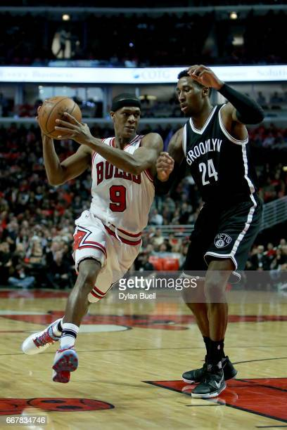 Rajon Rondo of the Chicago Bulls drives to the basket while being guarded by Rondae HollisJefferson of the Brooklyn Nets in the second quarter at...