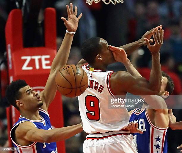 Rajon Rondo of the Chicago Bulls looses control of the ball after being hit in the face by Sergio Rodriguez of the Philadelphia 76ers as Timothe...