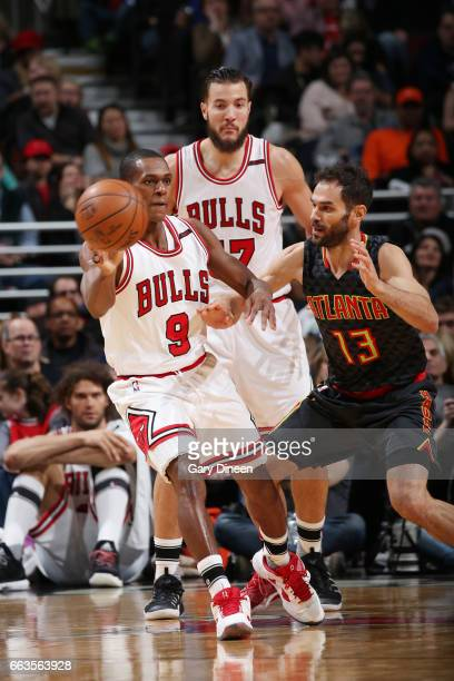 Rajon Rondo of the Chicago Bulls passes the ball against the Atlanta Hawks during the game on April 1 2017 at the United Center in Chicago Illinois...