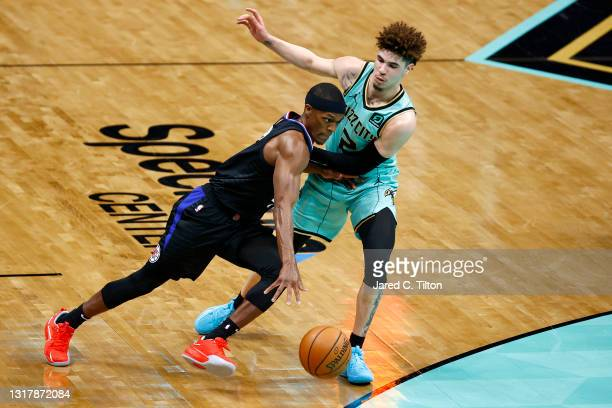 Rajon Rondo of the LA Clippers drives to the basket against LaMelo Ball of the Charlotte Hornets during the second quarter of their game at Spectrum...