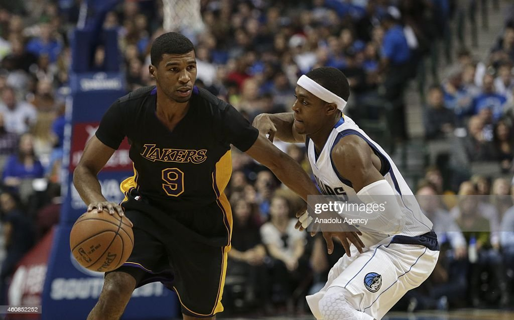 Rajon Rondo #9 of the Dallas Mavericks vies for ball against Ronnie Price #9 of Los Angeles Lakers during a basketball match on December 26, 2014 at the American Airlines Center in Dallas, Texas.