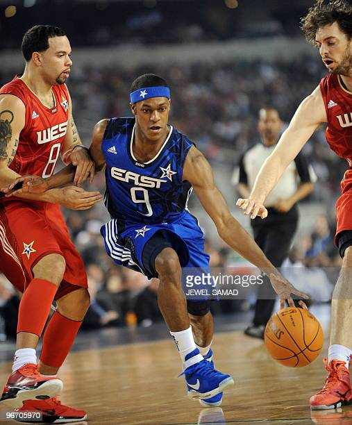 Rajon Rondo of the Eastern Conference dodges Pau Gasol and Deron Williams of the Western Conference during the NBA AllStar Game part of 2010 NBA...