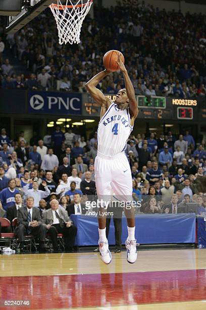 Rajon Rondo of the Kentucky Wildcats dunks against the Indiana Hoosiers during the game at Freedom Hall on December 11, 2004 in Louisville, Kentucky....