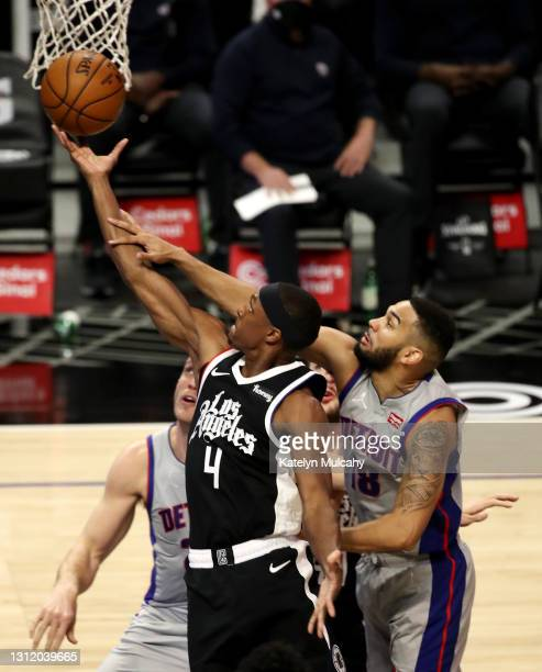 Rajon Rondo of the Los Angeles Clippers drives to the basket against Cory Joseph of the Detroit Pistons during the second quarter at Staples Center...