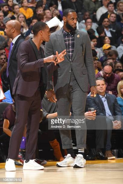 Rajon Rondo of the Los Angeles Lakers and LeBron James of the Los Angeles Lakers have a conversation on the bench during the game against the Detroit...