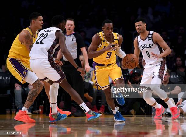 Rajon Rondo of the Los Angeles Lakers dribbles between Timothe LuwawuCabarrot and Caris LeVert of the Brooklyn Nets during a 104102 Nets win at...